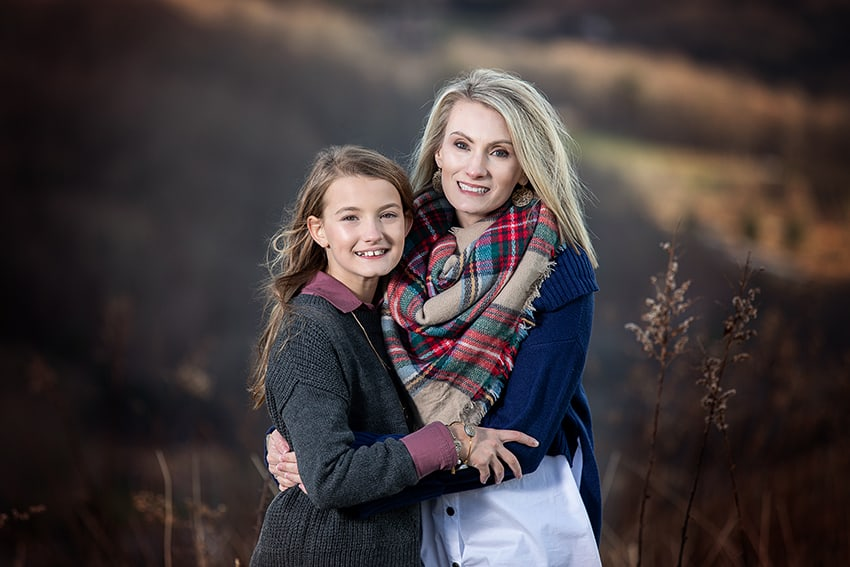Fall portrait of a mother and daughter with mountain backdrop