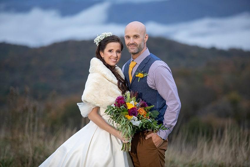 Bride and groom mountain views banner elk winery