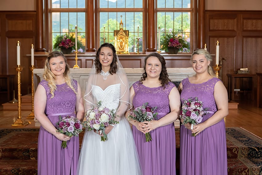 Bride and bridesmaids at St. Bernadette Catholic Church in Linville, NC