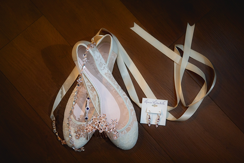 bride's shoes and earrings
